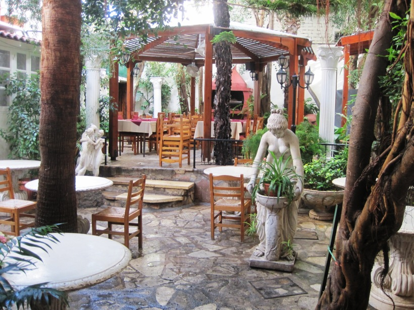 The indoor courtyard at the Kiniras Hotel